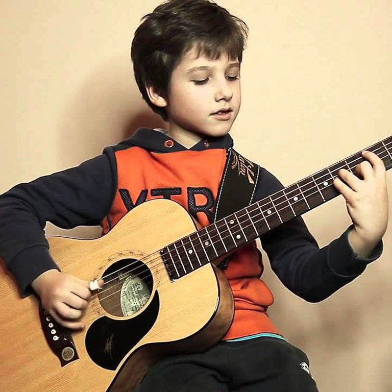 child_guitar_why_should_you_learn_to_play_the-_guitar